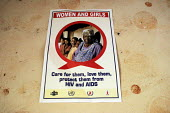 A poster outside a public awareness meeting held in a rural village hall, at a community-based scheme in a rural shanty town to support children orphaned by AIDS and related illnesses. Organised by SW... - Gerry McCann - 2000s,2005,Acquired immune,Acquired immune deficiency syndrome,advice advices,african,AIDS,campaign,CAMPAIGNING,CAMPAIGNS,CHILD,CHILDHOOD,children,community communities,deficiency syndrome,disease,dis