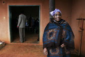 A public awareness meeting held in a rural village hall, at a community-based scheme in a rural shanty town to support children orphaned by AIDS and related illnesses. Organised by SWAPOL (Swaziland f... - Gerry McCann - (AIDS),(HIV),/,2000s,2005,Acquired,Acquired immune,AIDS,CHILD,CHILDHOOD,children,communities,community,deficiency,deficiency syndrome,disease,diseases,doorway,doorways,EMOTION,EMOTIONAL,EMOTIONS,entra