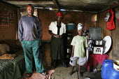 A family in the interior of their house, in a shanty area in Johannesburg. - Gerry McCann - 24-04-2005