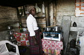 A woman cooking on a rudimentary stove, in a shanty area in Johannesburg. - Gerry McCann - 24-04-2005