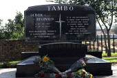The grave of Oliver Tambo, hero of the African National Congress (ANC) in Wattville Township near Johannesburg. - Gerry McCann - 2000s,2005,ACE,ace culture,African,Africans,anti-apartheid,cemeteries,cemetery,culture,date,dates,dead,death,DEATHS,democracy,died,EQUALITY,excluded,exclusion,flower,flowering,flowers,governing,grave,