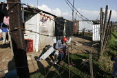 A man relaxing at the weekend, in a shanty area in Johannesburg. - Gerry McCann - 24-04-2005