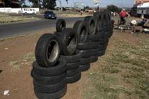 A man selling car tyres on the roadside. - Gerry McCann - 08-05-2005