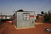 A shanty area in Johannesburg, with houses made from corrugated iron. - Gerry McCann - 08-05-2005