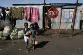 Children playing outside, in a shanty area in Johannesburg. - Gerry McCann - 08-05-2005