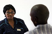 HIV/AIDS patients being provided with anti-retroviral drugs and confidential counselling, at St. Francis Care Centre in Boksburg, South Africa. - Gerry McCann - (H,/,2000s,2005,Acquired,Acquired immune,advice,ADVISE,adviser,advisers,advising,ADVISOR,ADVISORS,AIDS,Antiretroviral,ANTI-RETROVIRAL,badge,badges,care,centre,centres,CLINIC,clinics,communicating,comm