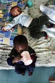 The Children's Section cares for children who have been abandoned or orphaned due to HIV/AIDS, at St. Francis Care Centre in Boksburg, South Africa. - Gerry McCann - (AIDS),(HIV),/,2000s,2005,abandoned,Acquired,Acquired immune,AIDS,babies,baby,bed,beds,boy,boys,care,carer,carers,centre,centres,child,childcare,CHILDHOOD,CHILDMINDING,children,children's,clinic,clini