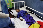 A girl who has contracted meningitis and TB, being cared for in the Children's Section. Where they look after children who have been abandoned or orphaned due to HIV/AIDS, at St. Francis Care Centre i... - Gerry McCann - 09-05-2005