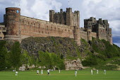 Sunday afternoon cricket on the village green at Bamburgh Castle on England's Northumberland Coast. - Gerry McCann - 27-07-2009