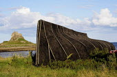 Up-turned hulls of old boats at Lindisfarne Castle on Englands Northumberland Coast. - Gerry McCann - 27-07-2009