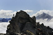 Walker on the summit rocks of the Ahornspitze, in Austrias Zillertal region in the Tyrol. - Gerry McCann - 05-08-2009