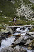 Walker on a footbridge on the Friesenberg in Austrias Zillertal region in the Tyrol. - Gerry McCann - 06-08-2009