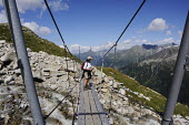 Walkers using a footbridge on the Olperer, in Austrias Zillertal region in the Tyrol. - Gerry McCann - 06-08-2009