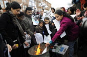 Demonstration over plans to relocate up to 600 families. Parents, children and their supporters gathered outside the Govan UK Border Agency (UKBA) HQ and burnt eviction letters which warned them they... - Gerry McCann - 20-11-2010