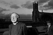 Dr Robert Runcie, Archbishop of Canterbury, visits Salford - Paul Herrmann - ,1980s,1989,bishop,BISHOPS,chauffeur,church,Church of England,churches,clergy,collar,dusk,EVENING,religion,religions,RELIGIOUS,RLB religion & belief,SUN,sunset,SUNSETS,TWIGHLIGHT,values,vicar,VICARS