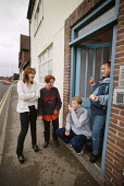 Young residents of a sheltered scheme for single homeless people chatting at the front door - Paul Herrmann - 24-02-1999