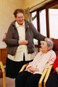 An elderly woman resident at a sheltered housing scheme with a care worker - Paul Herrmann - 24-02-1999