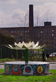 Sculpture of a Shapla or lotus flower, the national flower of Bangladesh and a symbol of Hinduism, in front of an old cotton mill building in Westwood, a largely Asian area of Oldham, Lancashire - Paul Herrmann - 29-05-2001