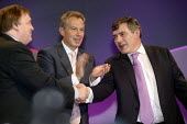 Prime Minister Tony Blair applauds and John Prescott shakes hands with Chancellor Gordon Brown after his speech at the 2006 Labour Party Annual Conference, Manchester, UK. - Paul Herrmann - 25-09-2006