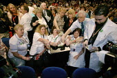 Unison delegation voting at the 2006 Labour Party Annual Conference, Manchester, UK. - Paul Herrmann - , boxes,2000s,2006,ballot,Ballot Box,BALLOTING,ballots,box,box boxes,boxes,card vote,care,Conference,conferences,delegate delegates,democracy,doctor,doctors,health,HEALTH SERVICES,healthcare,junior,Ma