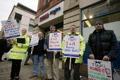Migrant workers, many Polish, and TGWU members, protest outside Tesco Metro in Manchester, alleging exploitation by one of the supermarket's fruit suppliers, S&A Produce - Paul Herrmann - 31-10-2006