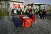 Demonstration on final day of a week-long strike at Fujitsu, Manchester. Empty seats at table represent management unwillingness to negotiate. - Paul Herrmann - 2000s,2007,amicus,DEMONSTRATING,demonstration,DISPUTE,DISPUTES,Empty,Fujitsu,industrial action,INDUSTRIAL DISPUTE,management,member,member members,members,negotiate,people,picket,picketing,PICKETS,PLA