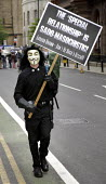 Anti-war protest outside Labour Leadership Conference, Manchester. Man in Guy Fawkes mask holds placard reading The Special Relationship is Sado-Masochistic - Gordon Brown don't be Bush's Bitch - Paul Herrmann - 24-06-2007