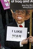 Stop the War Coalition and CND protest march outside Labour Party Conference in Manchester, UK. Gordon Brown mask and sign reads I Like War - Paul Herrmann - 20-09-2008