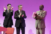 Lovemore Moyo, chair of the Movement for Democratic Change in Zimbabwe (R), is applauded by David Miliband and Gordon Brown after speaking at Labour Party Conference 2008, Manchester. - Paul Herrmann - 2000s,2008,Conference,conferences,MDC,MDC-T,Movement,Party,POL Politics,speaker,SPEAKERS,speaking,SPEECH,Zimbabwe