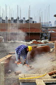 Construction worker sawing pipe. .... - Paul Herrmann - 19-10-2002