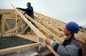 Construction workers secure roof timbers into place - Paul Herrmann - 19-10-2002