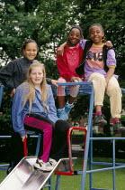 Four girls pose in a playground. .... - Paul Herrmann - 19-10-2002