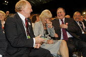 Neil Kinnock, Glenys Kinnock and John Prescott share a joke before the leader's speech at Labour Party Conference 2008, Manchester. - Paul Herrmann - 2000s,2008,communicating,communication,Conference,conferences,conversation,conversations,dialogue,discourse,discuss,discusses,discussing,discussion,EMOTION,EMOTIONAL,EMOTIONS,FEMALE,funny,humor,humoro