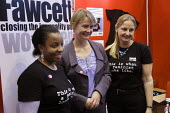 Yvette Cooper MP visits Fawcett Society Stand at Labour Party Conference 2008, Manchester. T-shirt slogan: This is what a feminist looks like. Closing the inequality gap. - Paul Herrmann - 2000s,2008,Closing,Conference,conferences,EMOTION,EMOTIONAL,EMOTIONS,equal rights,EQUALITY,FEMALE,FEMINISM,feminist,FEMINISTS,inequality,mp,mps,Party,people,person,persons,POL Politics,politician,poli