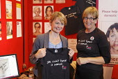 Yvette Cooper MP holds t-shirt reading You Can't Beat a Woman on Women's Aid stand at Labour Party Conference 2008, Manchester. - Paul Herrmann - 24-09-2008