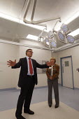 Health Minister Phil Hope MP with Angela Appleton, planning manager, in an ultra clean theatre, as he opens St Helens Hospital, the 100th hospital scheme built under the 2000 NHS Plan. - Paul Herrmann - 22-10-2008