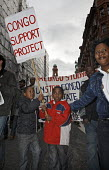 Demonstration against humanitarian crisis in Democratic Republic of Congo, in Manchester, UK. Children hold Congo Support Project banner. - Paul Herrmann - 08-11-2008