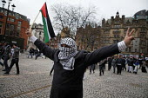 March against Israeli bombing in Gaza; Manchester, UK - Paul Herrmann - 2000s,2009,activist,activists,against,albert,BAME,BAMEs,black,BME,bmes,BOMB,bombing,bombings,BOMBS,CAMPAIGN,campaigner,campaigners,CAMPAIGNING,CAMPAIGNS,DEMONSTRATING,demonstration,DEMONSTRATIONS,dive
