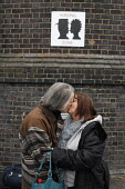 Warrington Bank Quay railway station, UK, has introduced a kissing zone, and a no kissing zone, the latter to avoid obstructions at the taxi rank. Here, two relatives kiss goodbye before a journey. - Paul Herrmann - 2000s,2009,affection,affectionate,Bank,BANKS,british,communicating,communication,cuddle,embrace,EMBRACING,hug,hugs,kiss,kissing,network,PEOPLE,rail,railway,RAILWAYS,relatives,SERVICE,SERVICES,sex,sexu