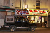 """A Land Rover belonging to the BNP """"save our culture"""" outside Oriential Express Chinese and Thai Takeaway in Leigh, Greater Manchester, UK. The vehicle was damaged during a protest which prevented the... - Paul Herrmann - 13-03-2009"""