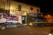 """A Land Rover and trailer belonging to the BNP """"save our culture"""" , outside Oriential Express Chinese and Thai Takeaway in Leigh, Greater Manchester, UK. The vehicle was damaged during a protest which... - Paul Herrmann - 2000s,2009,activist,activists,Anti Fascist,Anti Racism,bigotry,BNP,British,British National Party,CAMPAIGN,campaigner,campaigners,CAMPAIGNING,CAMPAIGNS,damaged,DEMONSTRATING,demonstration,DEMONSTRATIO"""