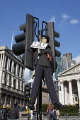 Eat The Bankers, dummy model of banker tied to traffic light outside Bank of England G20 meltdown, City of London on the eve of the London G20 Summit. - Paul Herrmann - 2000s,2009,activist,activists,against,anti,bank,bank of England,banker,bankers,banking,banks,CAMPAIGN,campaigner,campaigners,CAMPAIGNING,CAMPAIGNS,capitalism,capitalist,Credit Crunch,crisis,DEMONSTRAT