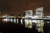 Skyline of Liverpool, UK, including new waterfront apartments overlooking docks at night. - Paul Herrmann - 10-01-2009