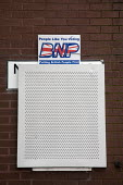 Advert for BNP on boarded-up house in Miles Platting, Manchester, UK. A BNP election sign: people like you voting BNP putting British people first. - Paul Herrmann - 10-06-2009