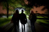 People walking through a Manchester park at night in the rain. - Paul Herrmann - 05-06-2009