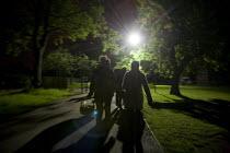People leaving Platt Fields park at night; Manchester, UK - Paul Herrmann - 06-06-2009