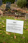 A notice at Southern Cemetery, Manchester, UK, after 20 Muslim graves were vandalised. Sign reads Due to an incident some headstones in this area may have been disturbed. - Paul Herrmann - 05-10-2009