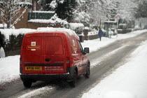 A Royal Mail van driving through snow Manchester, UK - Paul Herrmann - 05-01-2010