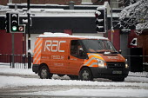 An RAC van in snow Manchester, UK - Paul Herrmann - 2010,2010s,cities,city,club,clubs,cold,DRIVER,DRIVERS,driving,gritted,highway,job,jobs,LAB LBR Work WEA Weather,maintaining,MAINTENANCE,Manchester,mechanic,MECHANICS,orange,people,precipitation,repair