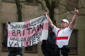 English Defence League members on march in Bolton with flag reading Sharia laws will destroy Britain and all our British values - Paul Herrmann - 20-03-2010